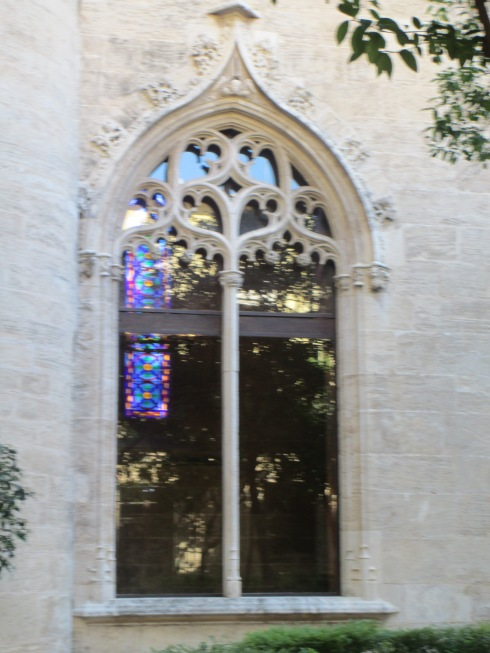 External window at La Lonja de la Seda with view of internal stained glass window