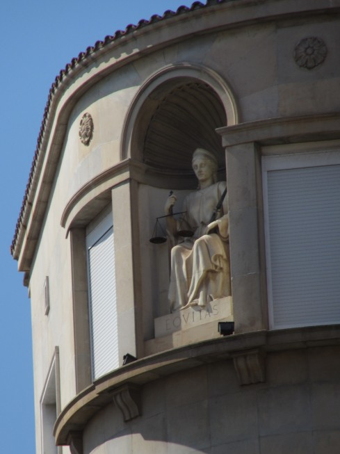Statue on top floor of building