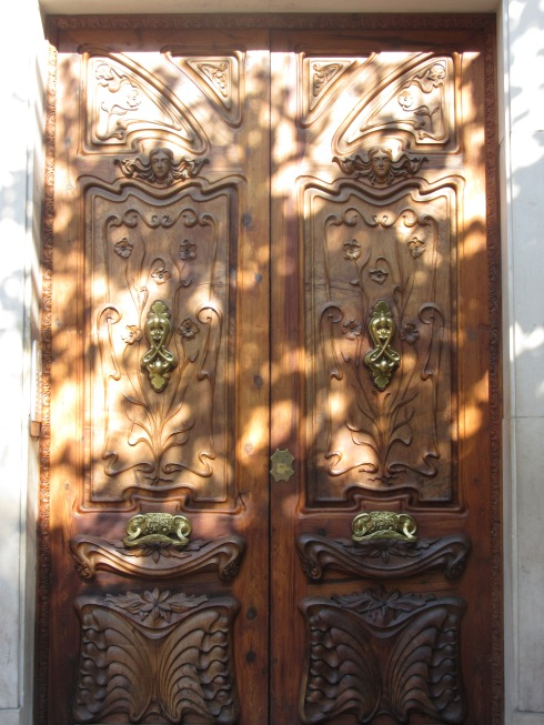 Ornate door with plays of shadow and light
