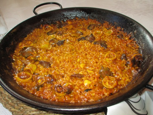 Paella with rabbit and calamari