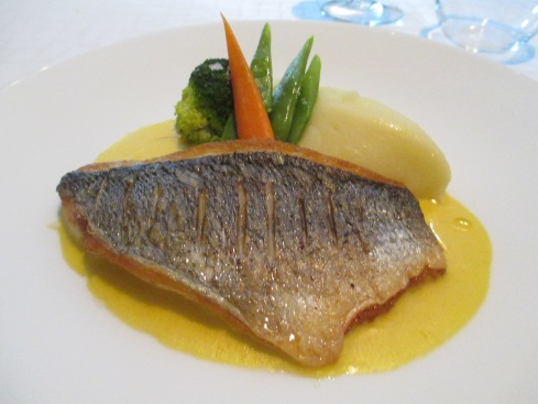 Sautéed fish with veggies in saffron sauce